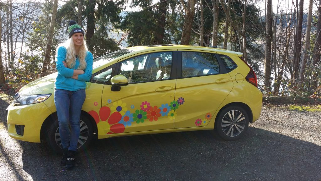 Carrie and Yellow Honda Fit with her Flower Power Decals