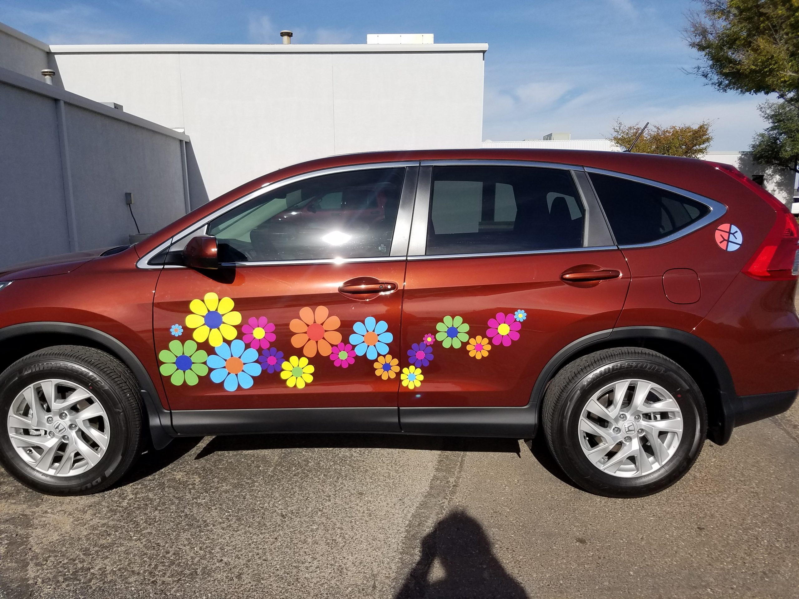 Red Honda Odessy Van with Flower Power Decals