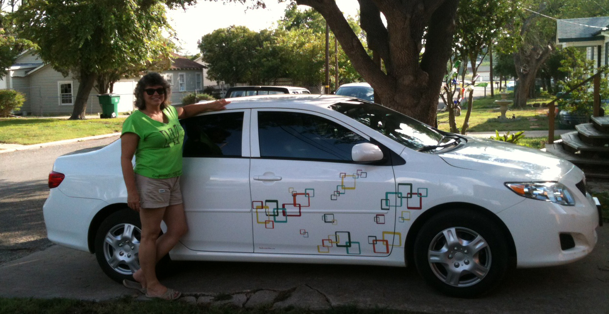 Fun square decals on white toyota corolla side view