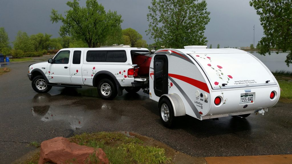 Red poppy decals on White Truck & Teardrop Camper the customer was the decal design and installer