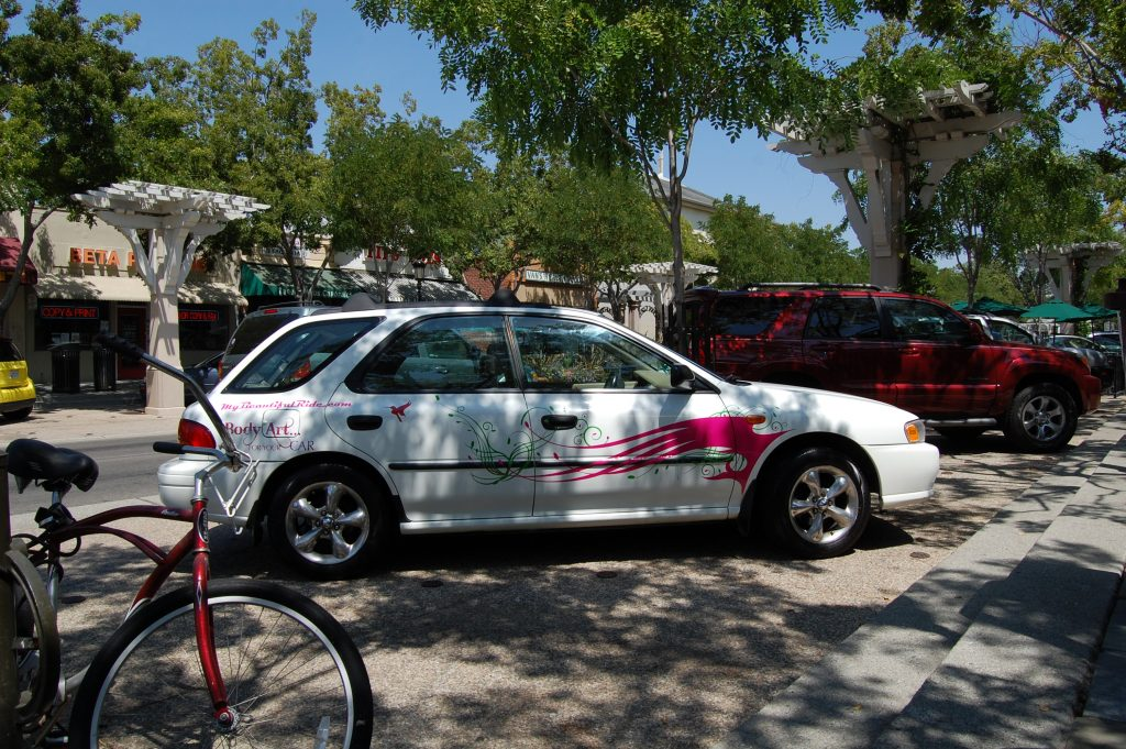 White Subaru body art for your car & hummingbird with pink green decals red bike in foreground