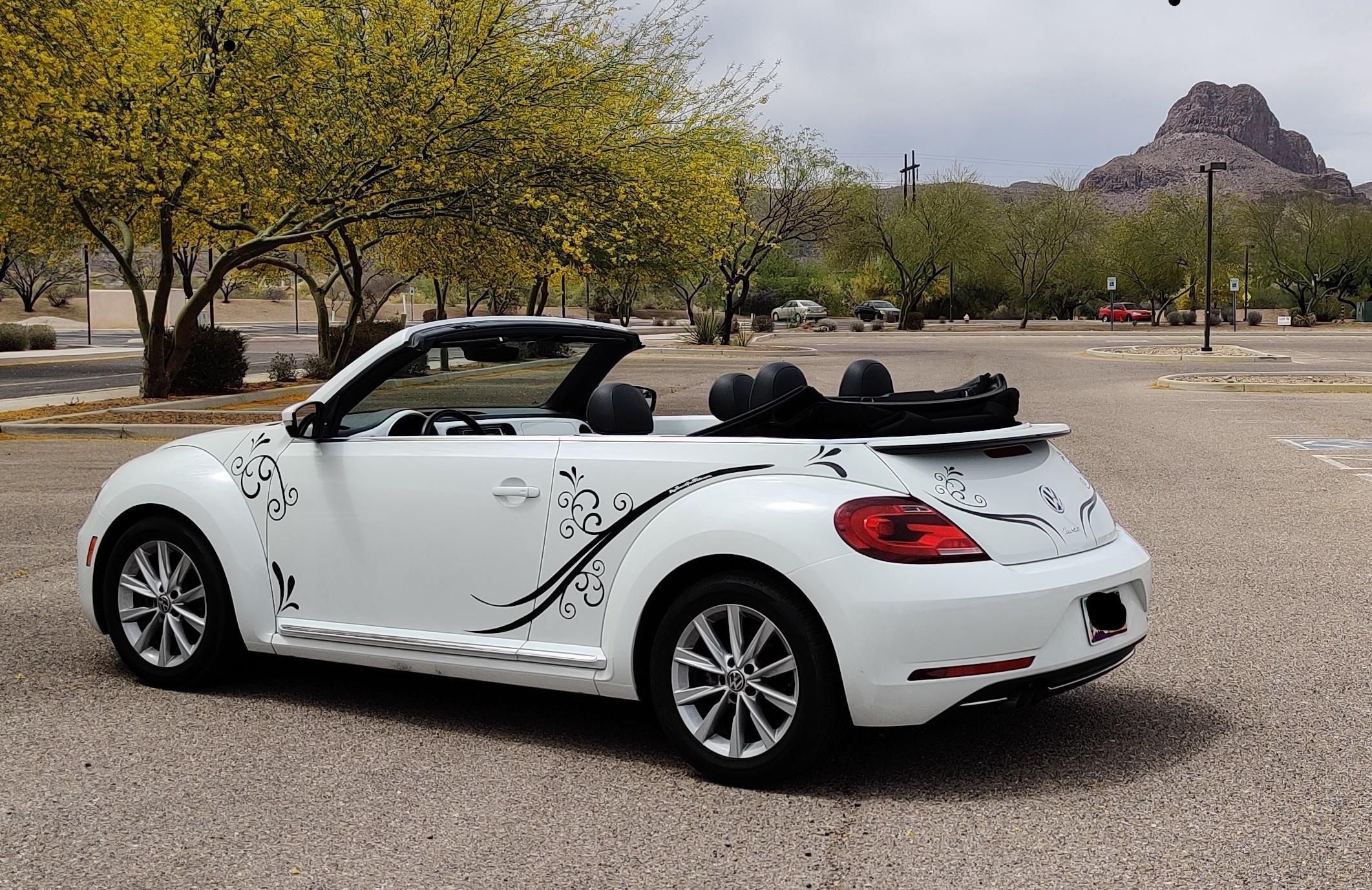 White VW Beetle with decal Arizona desert